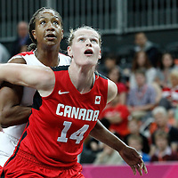 07 August 2012: USA Tamika Catchings vies for the rebound with Canada Tina Charles during 91-48 Team USA victory over Team Canada, during the women's basketball quarter-finals, at the Basketball Arena, in London, Great Britain.