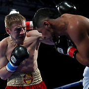 Ivan Golub (L) fights Luis Florez during a One For All Promotions boxing event at the Caribe Royale Orlando Events Center on Saturday, February 20, 2021 in Orlando, Florida. (Alex Menendez via AP)