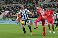 Newcastle United's Midfielder Siem de Jong holds the ball up from Liverpool's Defender Alberto Moreno  during the Barclays Premier League match between Newcastle United and Liverpool at St. James's Park, Newcastle, England on 6 December 2015. Photo by George Ledger.