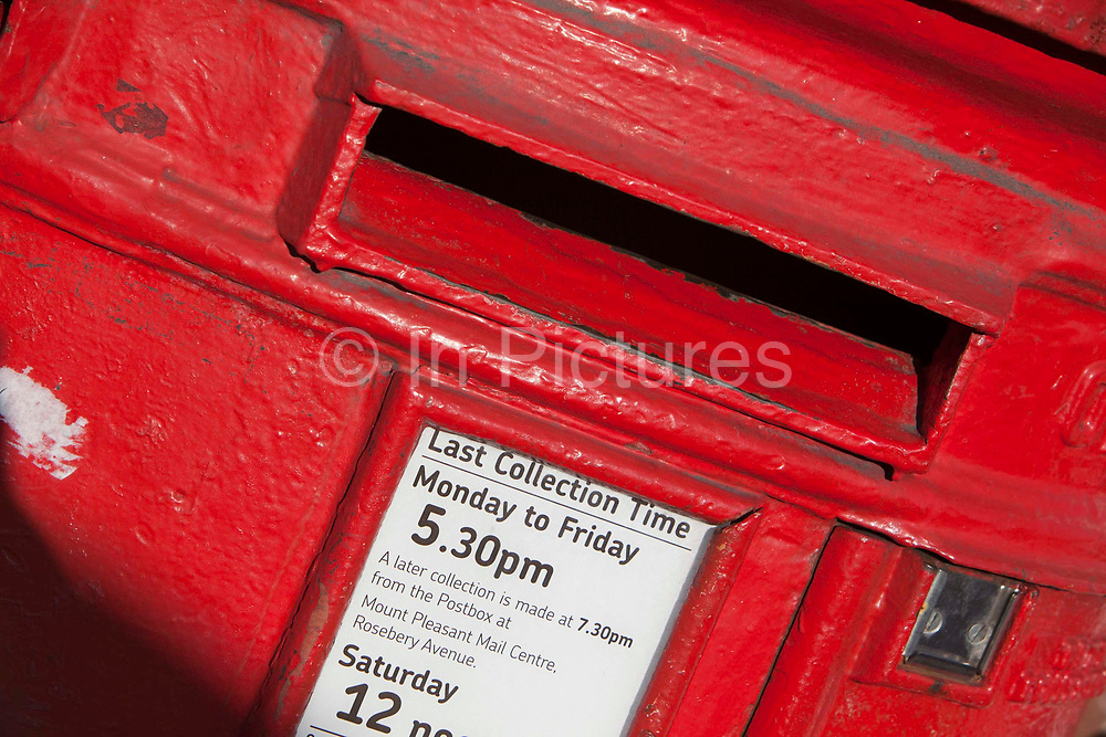 A British post box used for letters that are then collected every day by the Royal Mail, the British postal service.