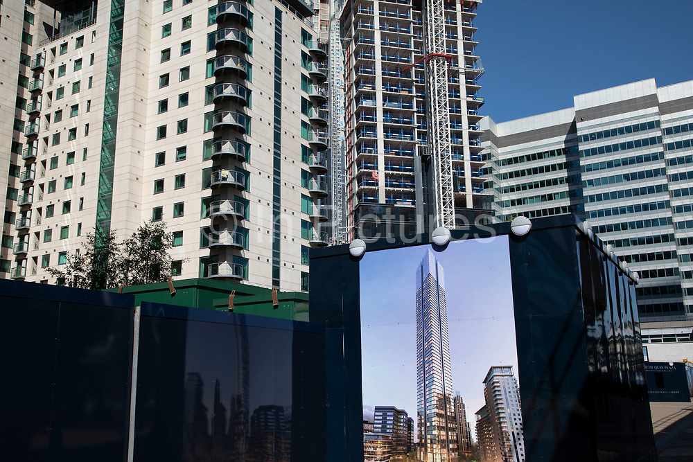 New apartment buildings under construction in Canary Wharf financial district in London, England, United Kingdom. Canary Wharf is a financial area which is still growing as construction of new skyscrapers continues.