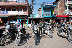 Regrouping in a town on Motorcycle Sherpa's Ride to the Heavens motorcycle adventure in the Himalayas of Nepal. Riding from Pokhara to the National Park in Chitwan, Monday, November 11, 2019. Photography ©2019 Michael Lichter.