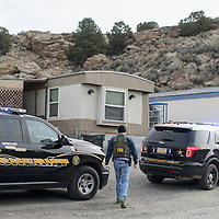 Agent Aaron Karpis with the FBI walks back to the scene of a narcotics raid in the Black Diamond Canyon Trailer Park in Gallup Thursday. Officers with McKinley County Sheriff's Department, Cibola County Sheriff's Department, and the FBI worked together to execute a search warrant on Robert Gonzales in response to neighbors complaining about him selling narcotics.