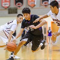 Miyamura Patriot Darin Baca (21) maneuvers past Gallup Bengal Cyrus John (30) Saturday at Gallup High School.
