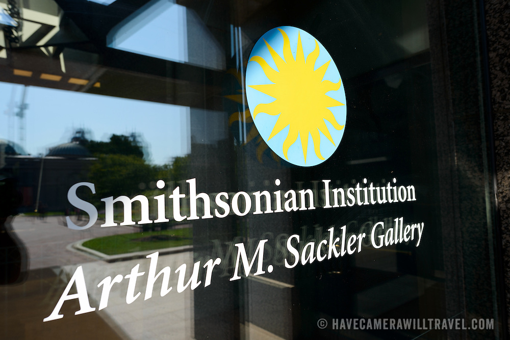 Sackler Gallery Sign on Glass. The Arthur M. Sackler Gallery, located behind the Smithsonian Castle, showcases ancient and contemporary Asian art. The gallery was founded in 1982 after a major gift of artifacts and funding by Arthur M. Sackler. It is run by the Smithsonian Institution.