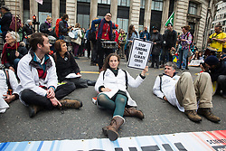 London, UK. 14 October, 2019. Climate activists from Scientists for Extinction Rebellion, including Dr Emily Grossman (c), block the busy junction at King William Street in front of London Bridge on the eighth day of International Rebellion protests across London. Today's activities were concentrated around the  City of London's finance district.