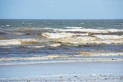 Hurricane Irma left a dirty churned up surf as a reminder of her recent push through Florida before Biketoberfest. Daytona Beach, FL, USA. Friday October 20, 2017. Photography ©2017 Michael Lichter.