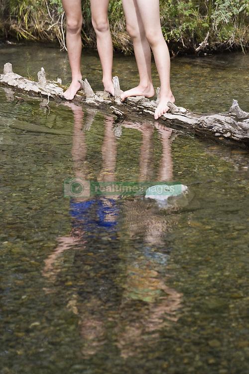 July 21, 2019 - Two Girls Standing On Log In Stream (Credit Image: © Carson Ganci/Design Pics via ZUMA Wire)
