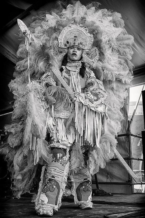 A member of the Big Chief Walter Cook and the Creole Wild West Mardi Gras Indians performs on the Jazz and Heritage Stage during the 2013 New Orleans Jazz & Heritage Music Festival at Fair Grounds Race Course on April 27, 2013 in New Orleans, Louisiana. USA.
