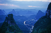 The Li river winds through the heavenly peaks of the Karst limestone mountains in the Yangshuo and Guilin landscape of Guangxi province in South East China.