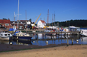 AREJG3 Boats, houseboats moored on River Deben, Woodbridge, Suffolk, England
