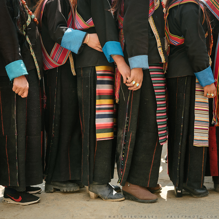 Layap women line up before a dance. The Tshechu of the Gasa monastery on the road leading to Laya. Tshechu are annual religious Bhutanese festivals held in each district on the tenth day of a month of the lunar Tibetan calendar. Tshechus are large social gatherings, which perform the function of social bonding among people of remote and spread-out villages.