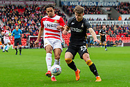Doncaster Rovers defender Niall Mason battles with Bradford city defender Connor Wood during the EFL Sky Bet League 1 match between Doncaster Rovers and Bradford City at the Keepmoat Stadium, Doncaster, England on 22 September 2018.