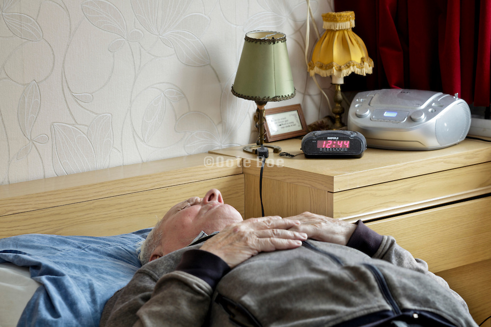 senior male person taking a nap during daytime