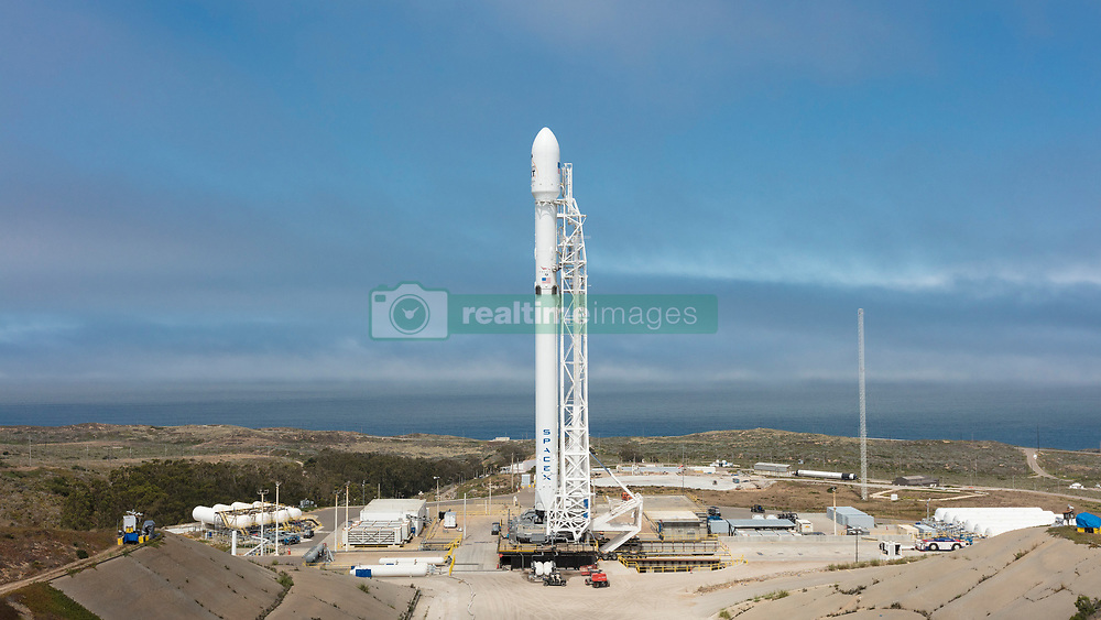 June 24, 2017 - Lompoc, CA, United States of America - The SpaceX Falcon 9 rocket stands ready for lift off carrying ten Iridium communications satellites for deployment in space from Vandenberg Air Force Base June 24, 2017 near Lompoc, California. Following the launch the Falcon first stage booster returned to earth landing successfully on a recovery platform in the Pacific Ocean. (Credit Image: © Spacex/Planet Pix via ZUMA Wire)