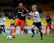 Leon Clarke of Sheffield Utd in action with Nathan Smith of Port Vale during the English League One match at Vale Park Stadium, Port Vale. Picture date: April 14th 2017. Pic credit should read: Simon Bellis/Sportimage