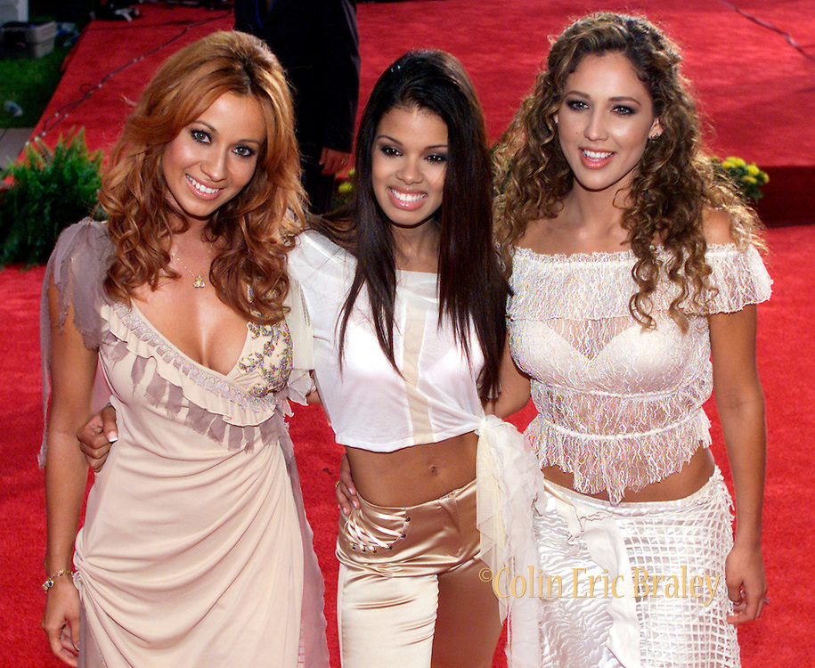 Latin pop group Miami Sound Machine mug for the cameras as they arrive at the 2002 Latin Billboard Awards show taping in Miami Beach, Florida May 9, 2002. The event showcases the music industry's hotest latin music stars, will air on the Telemundo network, May 12, 2002. REUTERS/Colin Braley
