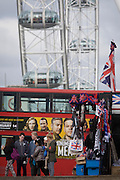 Tourism kiosk selling flags and souvenirs beneath the London Eye on the Southbank.