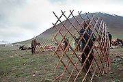 Setting up the yurt of the Khan, the tribal leader, during yearly summer migration. Afghan Kyrgyz are semi-nomadic people..Moving with the Khan (chief) family from the Qyzyl Qorum camp to the summer camp of Kara Jylga, on the south side of the wide Little Pamir plateau...Trekking through the high altitude plateau of the Little Pamir mountains (average 4200 meters) , where the Afghan Kyrgyz community live all year, on the borders of China, Tajikistan and Pakistan.