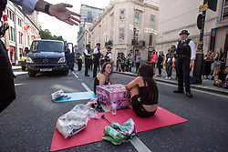 © Licensed to London News Pictures. 26/06/2020. London, UK. British Police arrested two activists after dozen of Canadian and British animal rights activists  block the street outside Canada House in central London; against a  law brought by the Ontario government known as Bill 156, under which, it is illegal to take photographs of animals in transport to slaughterhouses and give water to animals before their death. This legislation also prevents whistleblowers or investigative journalists from exposing animal cruelty at farms or slaughterhouses. <br /> <br /> Photo credit: Marcin Nowak/LNP
