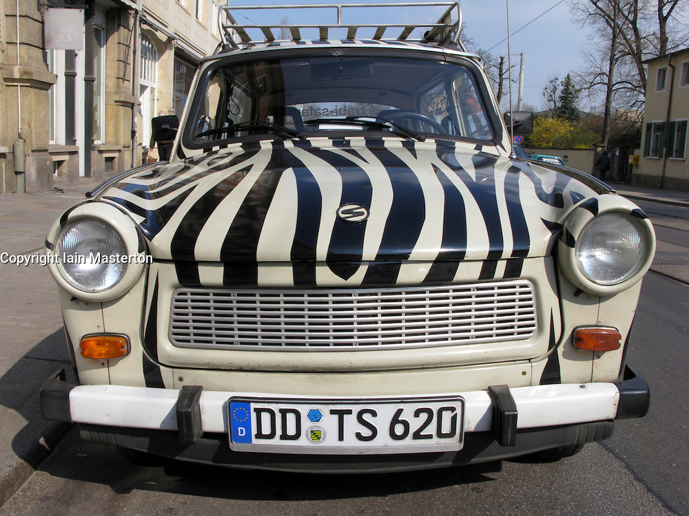 Original East German Trabant car painted with stripes and used as transport for tourists around Dresden in Germany. The tour company is called Trabi Safari