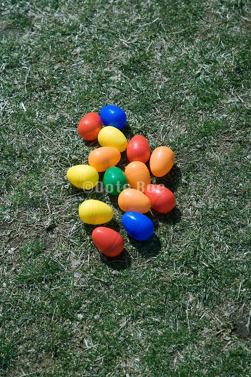 plastic Easter surprise eggs on grass
