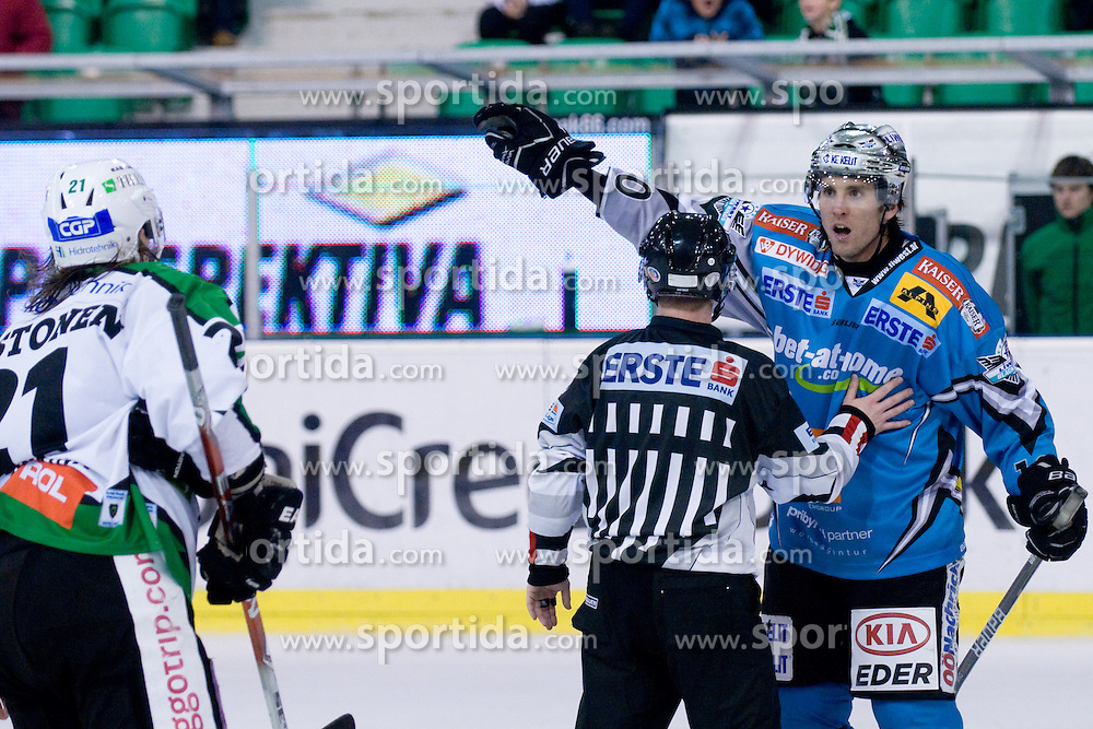 Reid Cashman (EHC Liwest Black Wings Linz, #10) and Tomi Mustonen (HDD Tilia Olimpija, #21) during ice-hockey match between HDD Tilia Olimpija and EHC Liwest Black Wings Linz in 37th Round of EBEL league, on Januar 9, 2011 at Hala Tivoli, Ljubljana, Slovenia. (Photo By Matic Klansek Velej / Sportida.com)