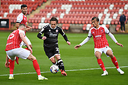 Sam Matthews (20) of Crawley Town breaks through the Cheltenham defence during the EFL Sky Bet League 2 match between Cheltenham Town and Crawley Town at Jonny Rocks Stadium, Cheltenham, England on 10 October 2020.