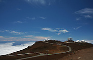 The rocky 10,000 ft. summit of Mt. Haleakala, House of the Sun, on Maui. .Mt. Haleakala is considered to be a semi-dormant volcano and features a 7 mile wide crater. .An observatory operated by the Department of Defense tracks man made objects in space.