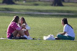 © Licensed to London News Pictures. 30/03/2021. London, UK. Members of the public picnic in a sunny Greenwich Park in South East London. Temperatures are expected to rise with highs of 23 degrees forecasted for parts of London and South East England today . Photo credit: George Cracknell Wright/LNP