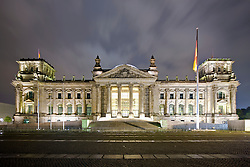 Facade of a government building lit up at dusk, The Reichstag, Berlin, Germany