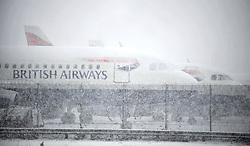 © under license to London News Pictures. 18.12.2010. BA planes lie covered in snow. British Airways has cancelled all flights to and from London Heathrow today (Sat) due to very heavy snow. Photo Credit should read Stephen Simpson/London News Pictures