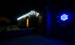 East Lothian, Scotland, United Kingdom, 9th December 2019. Christmas decorations around the villages. Locals decorate their houses with a variety of lights and Christmas decorations. A small cottage by the roadside.<br /> Sally Anderson   EdinburghElitemedia.co.uk