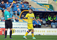 Stevie May of Sheffield Wednesday is booked by referee Mr Graham Salisbury for persistant fouling of the Huddersfield defence during the Sky Bet Championship match at the John Smiths Stadium, Huddersfield<br /> Picture by Graham Crowther/Focus Images Ltd +44 7763 140036<br /> 22/11/2014