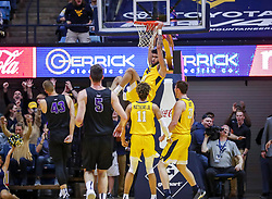 Mar 20, 2019; Morgantown, WV, USA; West Virginia Mountaineers guard Jermaine Haley (10) dunks the ball at the end of the first half against the Grand Canyon Antelopes at WVU Coliseum. Mandatory Credit: Ben Queen