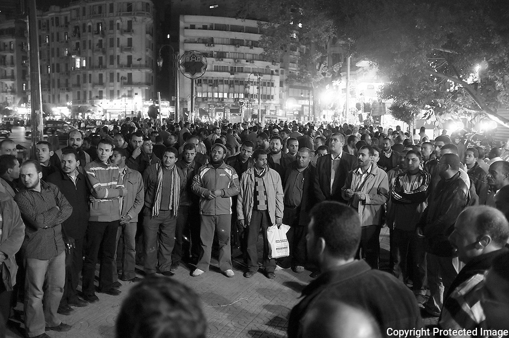 Singing songs  low,and in harmony  but with an air of conviction members of the muslim brotherhood gather in preparation for the million man march at tahrir Square  the next day Friday the 18th Cairo.