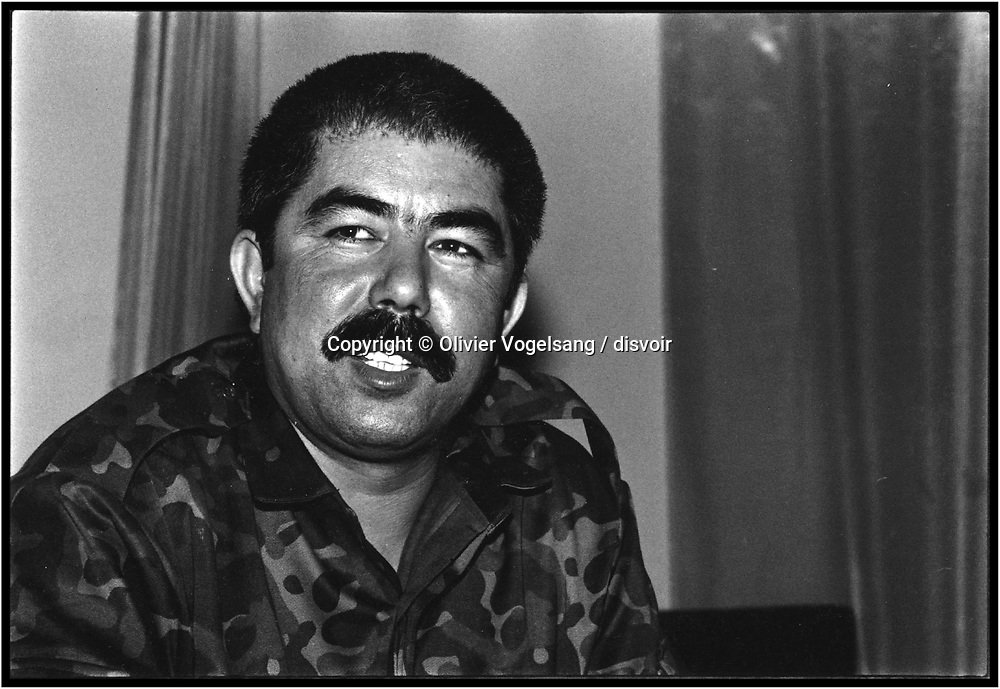 Afghanistan. Maazar-i Sharif. The General R. DOSTUM. Former ally of Najibullah. He(it) is strongly settled) in the North of the country. He recommends a federal state in the North with Maazar-i Sharif as capital. Robust warrior but poor politician. He does not know how to either read or write. Abdul Rashid DOSTUM, leader of the Uzbek militias, is