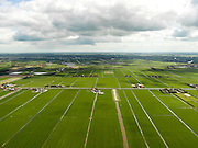 Nederland, Noord-Holland, Gemeente Schermer, 16-04-2012; Polder I, onderdeel van De Schermer, gezien naar  Eilandspolder met Beemster aan de verre horizon. .Polder I, part of the polder Schermer, .regular land division designed on purpose . .luchtfoto (toeslag), aerial photo (additional fee required);.copyright foto/photo Siebe Swart
