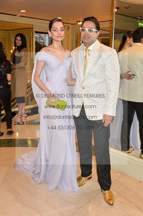 PAUL SAGOO and ZINNIA KUMAR at the 6th annual Asian Awards held at The Grosvenor House Hotel, Park Lane, London on 8th April 2016.