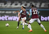 Football - 2020 /2021Premier League - West Ham United vs Fulham - The London Stadium<br /> <br /> West Ham United's Declan Rice battles with Fulham's Bobby De Cordova-Reid.<br /> <br /> COLORSPORT/ASHLEY WESTERN
