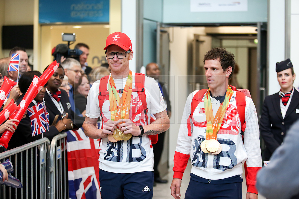 © Licensed to London News Pictures. 20/09/2016. London, UK. Team GB Paralympians Steve Bate and Adam Duggleby arrive at terminal 5 of London Heathrow Airport after flying on British Airways flight BA2016. Team GB finished second in the Paralympics medals table with 147 medals beating their total of 120 at London 2012. Photo credit : Tom Nicholson/LNP