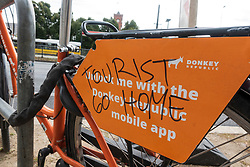 "Rental bicycle with ""Tourist Go Home"" message written on it in Berlin,Germany,"