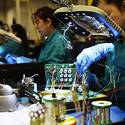 Duyen Dang assembles circuit boards at ControlTek, a circuit board manufacturer in Vancouver, Wash., that has been affected by tariffs.<br /> <br /> For the first year of President Trump's trade war with China, many American manufacturers found ways to get by -- making contingency plans, but avoiding long-term changes in anticipation of a deal. But now with a deal seemingly a long way off, and tensions likely to continue regardless, companies are revisiting that approach. Electronics manufacturers are caught up not just in the tariffs but also in the national security fight over Huawei and other firms.