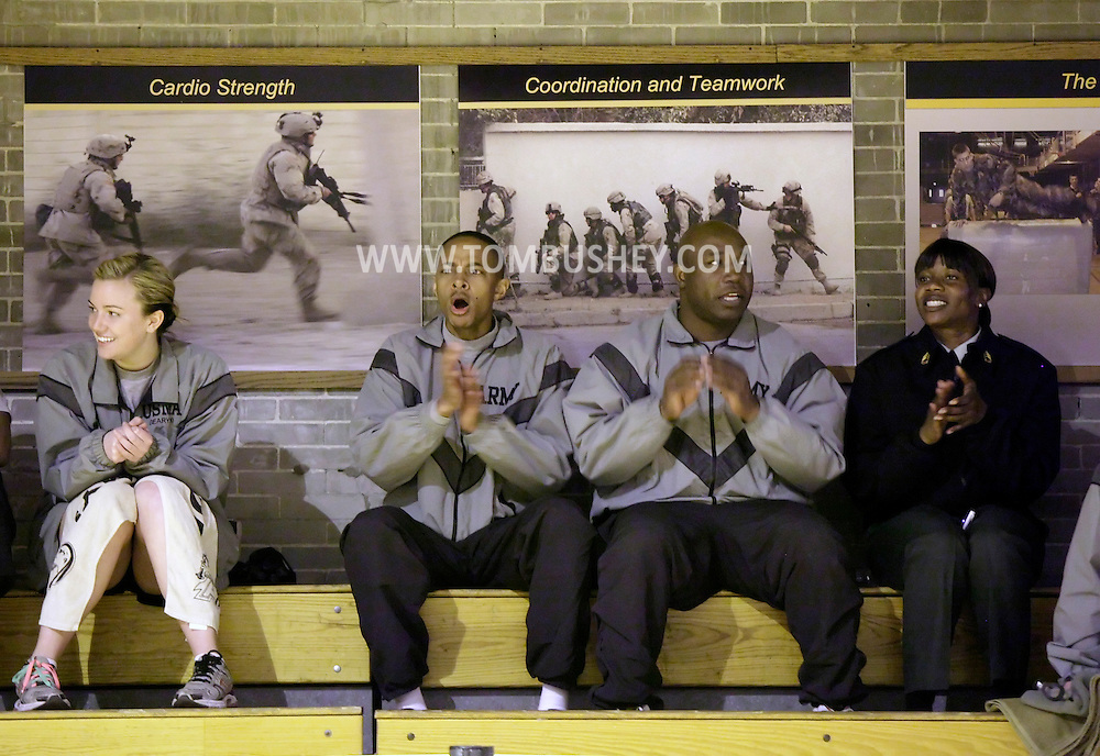 Spectators cheer for cadets completing the Indoor Obstacle Course Test in Hayes Gym at the U.S. Military Academy at West Point on Feb. 9, 2010.