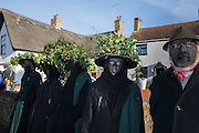 OLD GLORY MOLLY , The Straw Bear Festival, Whittlesey,Peterborough. 17 January 2016<br /> On Plough Tuesday, the day after Plough Monday (the first Monday after Twelfth Night), a man or boy is covered from head to foot in straw and led around the town where  he would dance in exchange for gifts of money, food or beer. The custom was was resurrected by the Whittlesea Society in 1980.