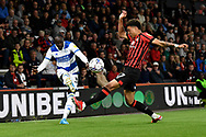Albert Adomah (37) of Queens Park Rangers battles for possession with Morgan Rogers (27) of AFC Bournemouth during the EFL Sky Bet Championship match between Bournemouth and Queens Park Rangers at the Vitality Stadium, Bournemouth, England on 14 September 2021.