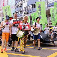 Protesters walk in unity during June protests in Hong Kong. Protesters are opposed to a controversial extradition bill.