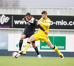 Falkirk's Phil Roberts and Queen of the South's Mark Durnan.<br /> Falkirk 1 v 0 Queen of the South, Scottish Championship game today at the Falkirk Stadium.<br /> © Michael Schofield.