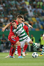 August 15, 2017 - Lisbon, Portugal - Sporting's forward Daniel Pondence from Portugal vies with Steaua's midfielder Mihai Pintilii  (L) during the UEFA Champions League play-offs first leg football match between Sporting CP and FC Steaua Bucuresti at the Alvalade stadium in Lisbon, Portugal on August 15, 2017. (Credit Image: © Pedro Fiuza/NurPhoto via ZUMA Press)