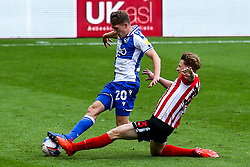 Cameron Hargreaves of Bristol Rovers is tackled by Denver Hume of Sunderland - Mandatory by-line: Robbie Stephenson/JMP - 12/09/2020 - FOOTBALL - Stadium of Light - Sunderland, England - Sunderland v Bristol Rovers - Sky Bet League One